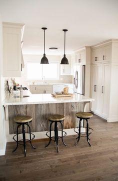 farmhouse white kitchen with stools