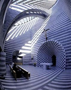 Church of San Giovanni Battista in Mogno Switzerland. The patterns were created by using alternating layers of native white marble and grey granite. Rockstar architect is Mario Botta.