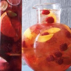 Raspberry-Mango Sangria  1 mango (peeled pitted flesh thinly sliced lengthwise) 1 cup raspberries 3 tbsps raspberry liqueur 750 mls wine (rose) 4 cups lemon-lime soda (chilled) ice
