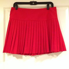 Aqua red pleated skirt Gorgeous red colored pleated skirt from Aqua. Great for work or for the weekend. Only worn once! Back zipper and clasp. Aqua Skirts