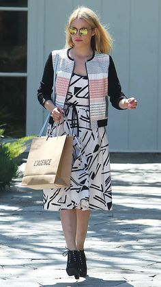 DIANNA AGRON Agron added retro charm to her mixed print ensemble with round mirrored frames.