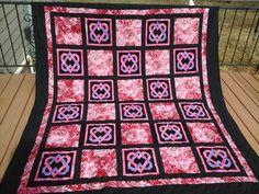 QUILT OF STARS FOR A STAR, a pieced Celtic heart pattern.