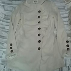 LUX Pea coat Very cute off-white/cream colored Lux  Pea coat... Very gently used, only worn a couple times. There are couple smaller wholes on the inside, they are hidden and are NOT noticeable  you have to look for them to see them. *Pictures upon request...*  Shell 90% wool 10% viscose  Lining 100% Acetate  Made in Sal Lanka  Dry clean only Lux Jackets & Coats Pea Coats