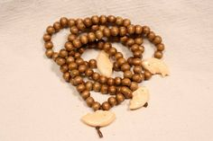108 Wood Bead and Bone Fish Buddhist Rosary Mala by QuietMind, $28.00