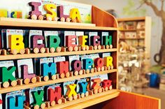 Learning puzzles like the brightly colored wooden alphabet letters on wheels from the franchise toy store Brilliant Sky Toys & Books make the perfect name builder for young children learning to read.
