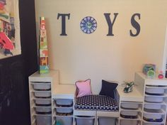 Our kids' play area. We used the Trofast storage from IKEA and created a reading nook. The kiddos love it :)