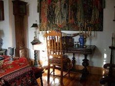 Our client Hans' antique Dutch style room, evoking the Golden Age of Northern Baroque art. The vintage Flemish Candelabra that Hans found at EuroLux Antiques is at home on a refectory table beneath a tapestry. EuroLuxAntiques.com