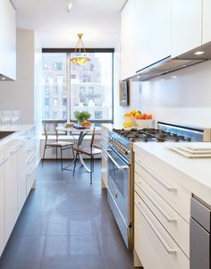 The stainless steel Bertazzoni Professional range cooker with 6 gas burners fits neatly into this galley kitchen in a New York apartment.