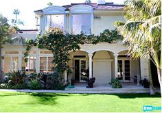 Dream home!  Rachel Zoe's new home.  The kitchen is bananas-- and there is an actual conservarory.  I die.
