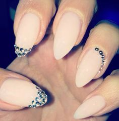 Nude stiletto nails...i really like the nude color