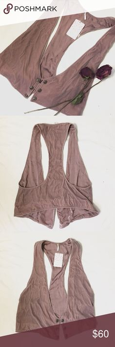 FP Velvet Vest In beautiful dusty rose, this vintage inspired velvet vest from Free People features crested metal buttons and a silky interior.  Size medium, but could fit a small or large as well.  Brand new with tags!    **BOGO 50% OFF or B2GO FREE for all my followers today and Sunday ONLY** Free People Jackets & Coats Vests