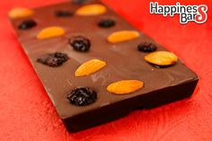 Made for Trishal Kumar is this delicious dark chocolate happiness bar with whole almonds and cranberries!