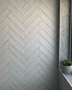 Matt white herringbone in new classic. Who is planning on doing it? This is the Cowra Subway tile with silver grey grout… White Tiles Grey Grout, Herringbone Subway Tile, Grey Subway Tiles, White Bathroom Tiles, Bathroom Floor Tiles, Hall Bathroom, Concrete Bathroom, White Bathrooms, Bathroom Interior Design