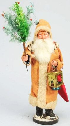 """12"""" Santa candy container holding a lush feather tree and carrying a bag of toys and lantern.  Love the spotted collar."""