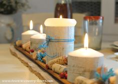 For this easy Fall centerpiece, I simply lined candles up on a wooden French baguette board.
