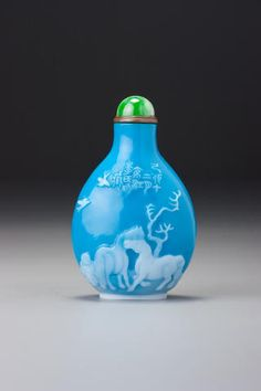 China, An inscribed white and turquoise-blue glass snuff bottle Yangzhou School, probably Li Junting, dated 1819