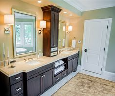Master bathroom idea- two smaller mirrors  with storage in the middle?