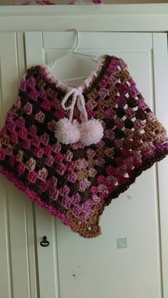 Check out this item in my Etsy shop https://www.etsy.com/listing/264872727/toddler-poncho-with-pompoms