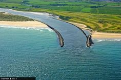 The mouth of the River Bann, at Castlerock, Co Londonderry, Northern Ireland. Portstewart strand to the left, Castlerock beach to the right.