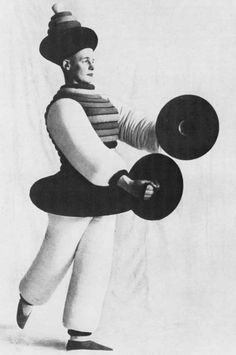 Triadisches Ballett (premiere in Stuttgart in 1922) was a ballet developed by Oskar Schlemmer, a German artist associated with the Bauhaus.