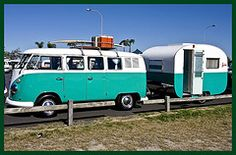 Sweet VW bus and vintage trailer. Looks like they are headed to the beach.