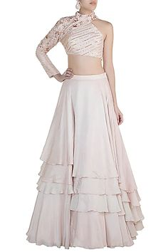 Featuring a nude crop top in silk base with rose gold embroidery on one sleeve. It is paired with matching layered lehenga skirt. FIT: Fitted at bust and waist. CARE: Dry clean only. Indian Fashion Designers, Indian Designer Outfits, Designer Dresses, Designer Sarees, Lehnga Dress, Lehenga Skirt, Anarkali, Indian Wedding Outfits, Indian Outfits