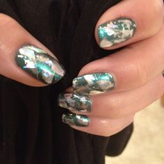 CND Shellac Asphalt layered with Iced Coral and foil. Probably too wild for me but cool!