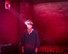 Ronghui Chen - Wei works in a factory in Yiwu, eastern China, coating polystyrene snowflakes with red powder. He wears a Christmas hat to protect his hair, and goes through at least six face masks a day. According to the Chinese government press agency, 600 factories in Yiwu produce around 60 percent of the world's Christmas decorations. The factories are staffed largely by migrant laborers, who work 12-hour days for between 270 and 400 euros a month.