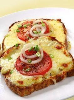 Whole grain bread low-fat mozzarella cheese, sliced thick tomato slices, white onion slices, and green onion.