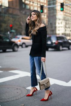 Love this outfit! Jeans, great black top and great red heels! <3