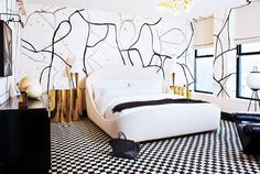 Black and white bedroom with gold side tables