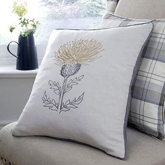 Ochre Balmoral Thistle Cushion | Dunelm