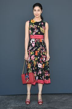 In a Gucci Garden printed crêpe de Chine silk dress outside the men's Gucci Spring Summer 2017 fashion show, Caroline Issa also wears embellished peep-toe pumps and chain shoulder bag from the Pre-Fall 2016 collection.