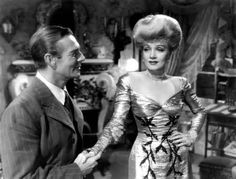 """Randolph Scott and Marlene Dietrich in """"The Spoilers"""" wearing Joseff Hollywood Jewelry"""