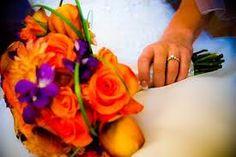 Orange roses & purple orchids.  Bridal bouquet inspiration.