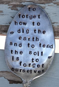 To Forget How To Dig The Earth and To Tend The Soil is to Forget Ourselves hand stamped Vintage Spoon Garden Art Gandhi. $14.99, via Etsy.