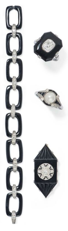 A GROUP OF ART DECO DIAMOND AND ONYX JEWELLERY, CIRCA 1930. Comprising: a bracelet, a rectangular claw-set cut cornered onyx and diamond panel ring, a French platinum and pearl single stone ring, and a navette-shaped onyx panel brooch. #ArtDeco