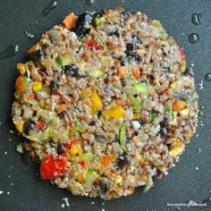 The Ultimate Veggie Burger- loaded with corn, tomatoes, and other yummy vegetables! #vegetarian- sub a flax egg