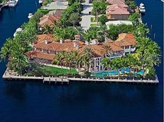 Florida, the Sunshine State, is overflowing with swimming pools, but few can measure up to the grotto-like construction that accompanies this offering in Fort Lauderdale. Fronting directly on the Intracoastal waterway, the 17,800-square-foot, 31-room mansion includes a 102-foot swimming pool, complete with waterfall, water slide, jacuzzi, and resort-style built-in bar. Inside the house lie nine bedrooms and no fewer than 15 bathrooms, along with a 2,000-square-foot great room and space fo
