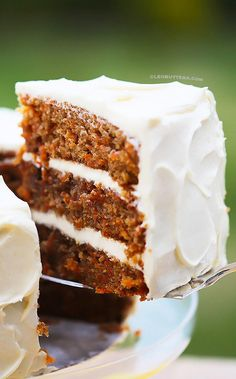 Simply classic, good old fashioned Carrot Cake, that might just become your absolute favorite. With luscious swoops of super creamy, perfectly sweet, (and stable) Cream Cheese Frosting, this cake is pretty much perfection.