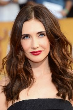 Carice Van Houten in a matte wine red.