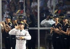 Lewis Hamilton blows a kiss to the crowd after securing the title #AbuDhabi2014