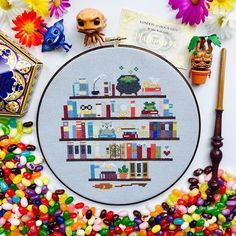 Harry Potter Bookshelf Cross Stitch Hoop Ah! I'm finally finished! It took a while to adapt this pattern from Rachel's at Fuzzy Fox Designs and spent a long time choosing colors for all the books. Can you spot the seven books … Cross Stitching, Cross Stitch Embroidery, Embroidery Patterns, Hand Embroidery, Machine Embroidery, Cross Stitch Hoop, Cross Stitch Designs, Free Cross Stitch Patterns, Cross Stitch Art