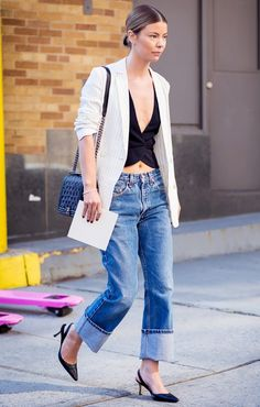 Stylist Annina Mislin dresses up her low-rise jeans with a cool crop top and pinstriped blazer.