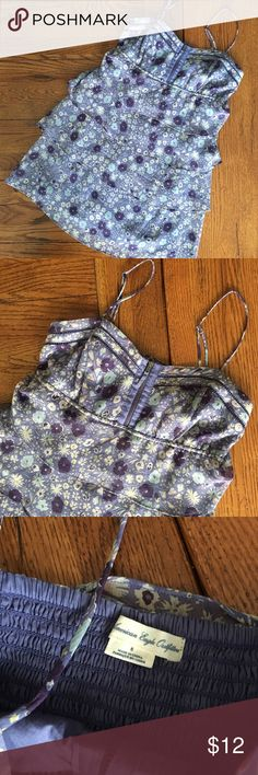 🐰💐American Eagle Floral Tiered Dress, Size 8 Darling American Eagle Floral Dress in excellent used condition.  Perfect for spring and Easter!  100% polyester.  Adjustable straps.  Stretchy back allows for larger bust.  Open to offers.  😀 American Eagle Outfitters Dresses