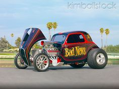 "AUT 26 RK2822 01 - 1937 Fiat Topolino Hot Rod ""Bad News"" Black And Red 3/4 Front View On Pavement - Kimballstock"