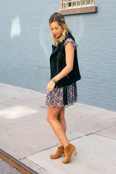 Fall fashion outfit: leather vest, floral print dress, fall fashion, chunky boots