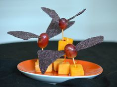 Bat Bites -- Healthy Halloween recipes and party ideas. I love bats, so this one was a must! Raw vegan tips: Use mango cubes instead of cheese, and raw chips or kale as 'wings'