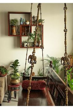 A healthy indoor plants and traditional indian swing in living room. | Home Tour: A beautiful Antique Modern home in Bangalore ~ The Keybunch Decor Blog Indian Swing, Brick Cladding, Vintage Trunks, Barbie Dream House, Stone Flooring, Green Plants, Decorating Blogs, House Tours, Ladder Decor