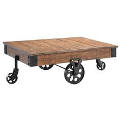 Bring industrial-inspired flair to your living room or den with this cart-style coffee table, crafted of reclaimed wood and iron and showcasing a wheeled bas...